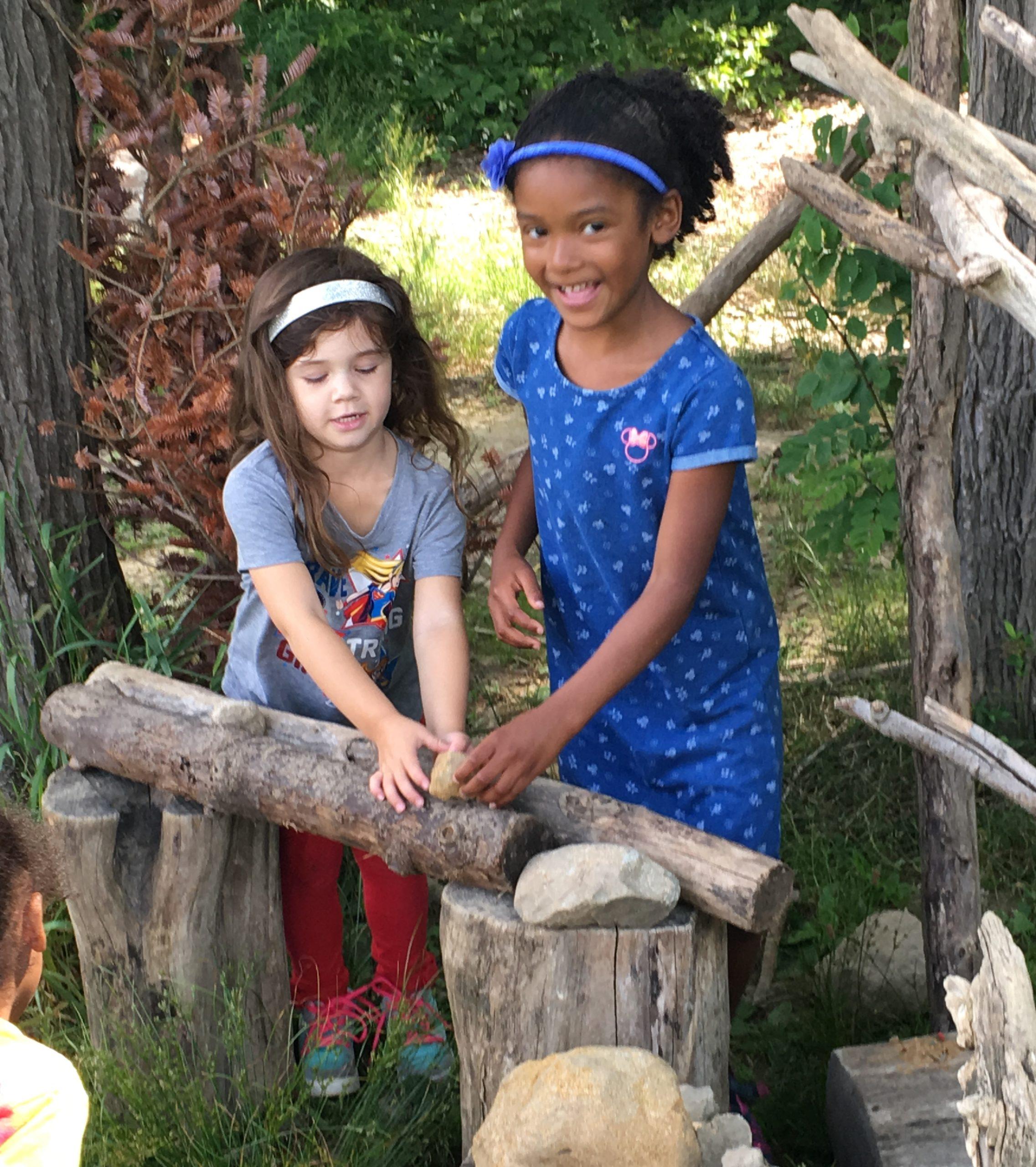 Children's House children enjoying outdoors