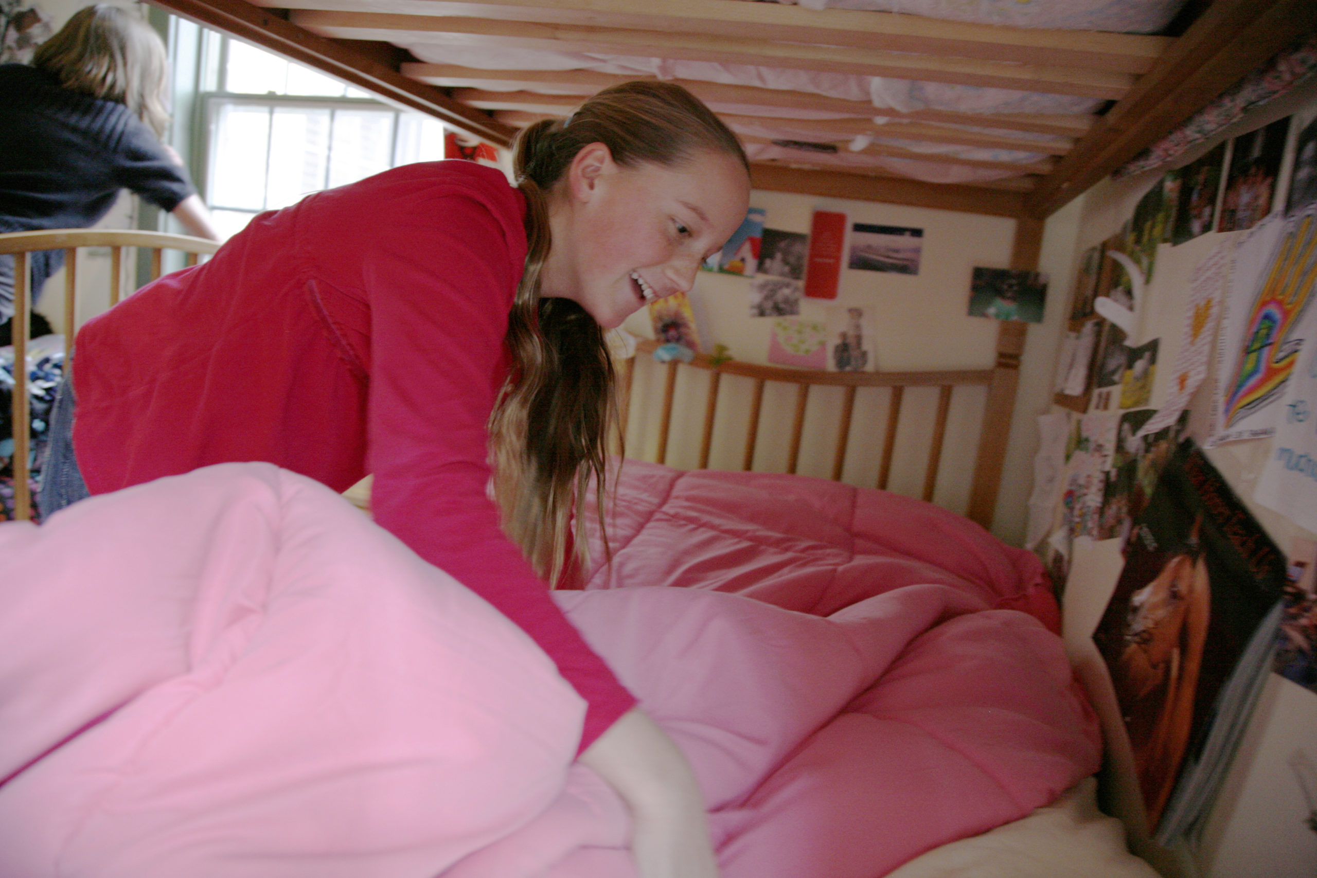 Hershey Montessori School boarding student makes bed